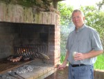 2011 Oct 22nd Punta parilla - cooking with a caipiranha in hand.JPG